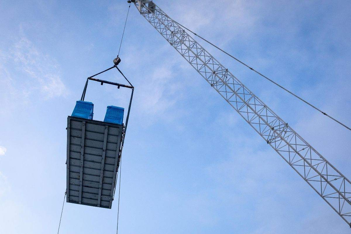 HVAC Equipment being lifted to the 10th story rooftop.